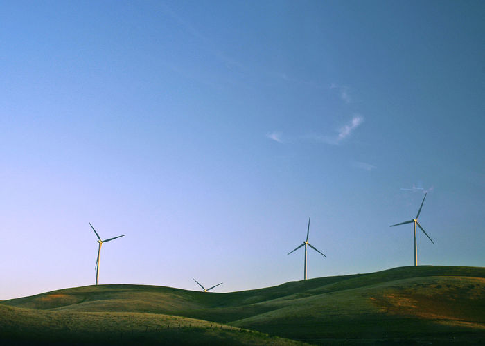 Alternative Energy Beauty In Nature Blue Day Environment Environmental Conservation Field Fuel And Power Generation Landscape Nature No People Renewable Energy Rural Scene Scenics - Nature Sky Sustainable Resources Tranquility Turbine Wind Power Wind Turbine