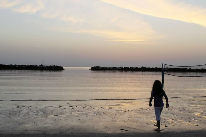 silhouette Holiday Adult Babygirl Beach Beauty In Nature Day Full Length Leisure Activity Lifestyles Nature One Person Outdoors People Real People Rear View Sand Scenics Sea Sea And Sky Silhouette Photography Sky Standing Sunset Vacation Water