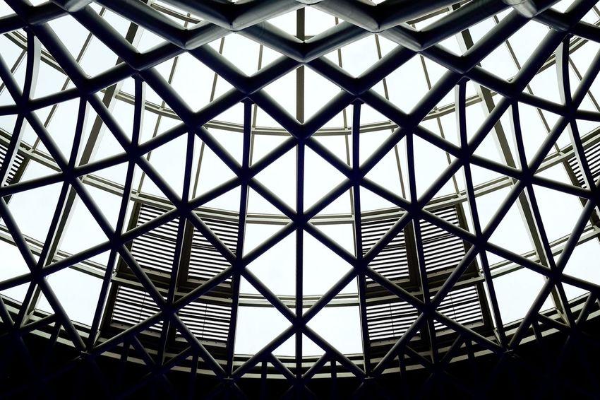 Backgrounds Full Frame Pattern Triangle Shape Sky Architecture Skylight Architectural Design Architecture And Art Architectural Feature Arched LINE Geometric Shape Architectural Detail Triangle Crisscross Girder Seamless Pattern Directly Below