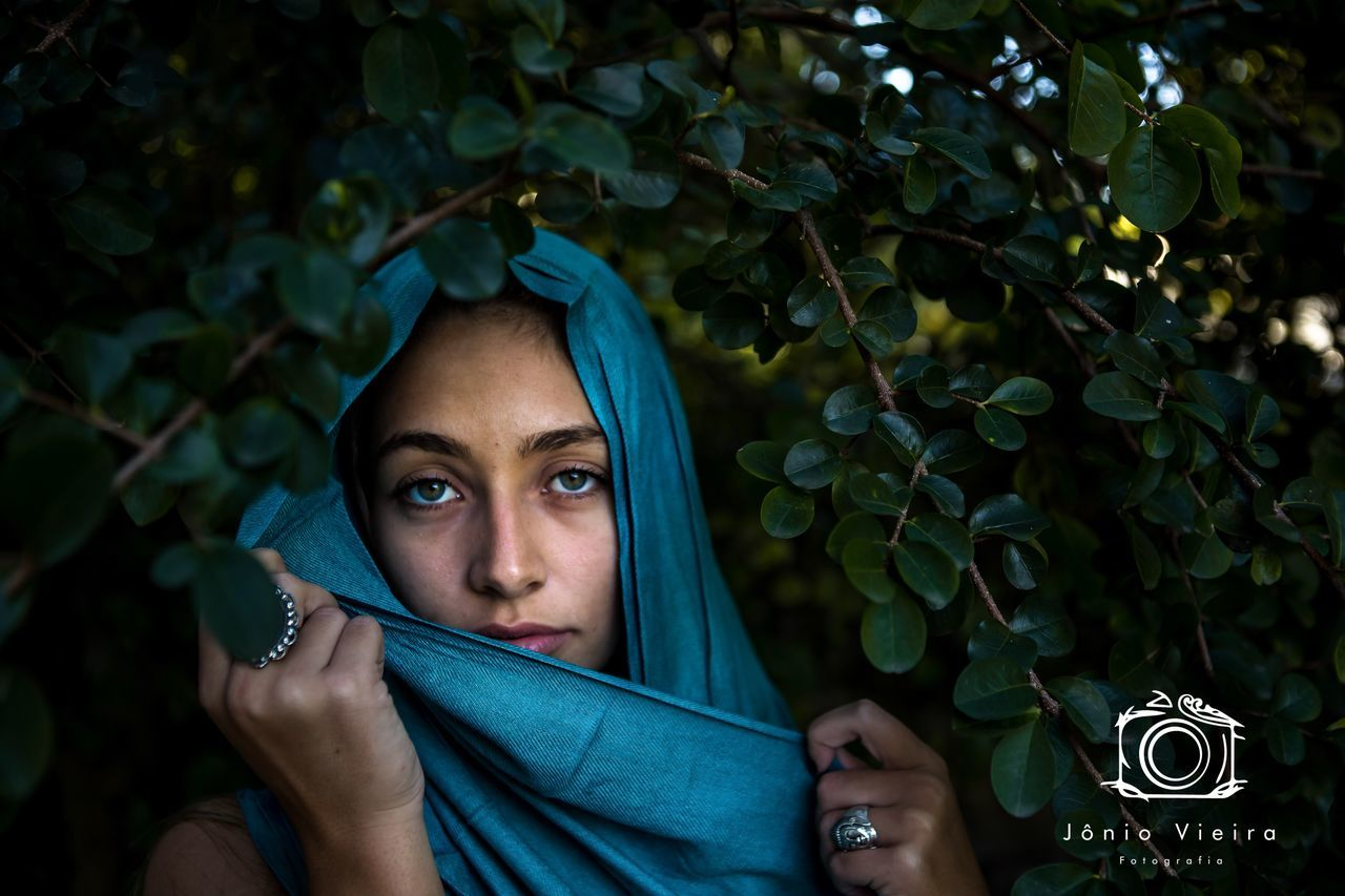young adult, beautiful woman, young women, one person, real people, looking at camera, leaf, portrait, green color, headshot, tree, outdoors, lifestyles, day, beauty, close-up, nature, people