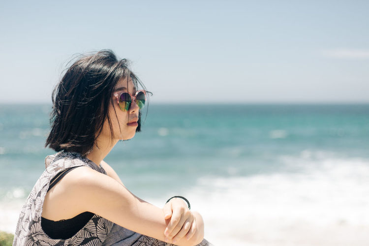 Glasses Sunglasses Sea One Person Fashion Land Beach Young Adult Water Leisure Activity Focus On Foreground Lifestyles Nature Real People Day Sky Young Women Hairstyle Women Hair Horizon Over Water Outdoors Beautiful Woman Travel Destinations People Portrait