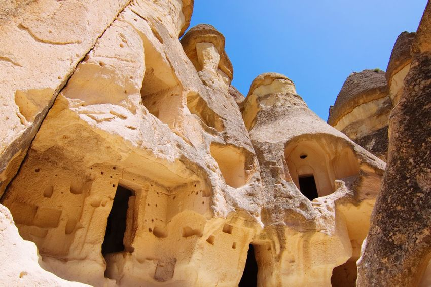 fairy chimneys in cappadocia Fairy Chimneys Cappadocia Kapadokya Turkey SONY A7III Knycl EyeEm Selects Sunlight Nature Architecture No People Art And Craft History Rock Formation Travel Clear Sky Outdoors Built Structure Building Exterior Creativity Sky Day Solid Low Angle View