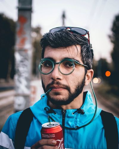 Portrait of young man drinking glasses