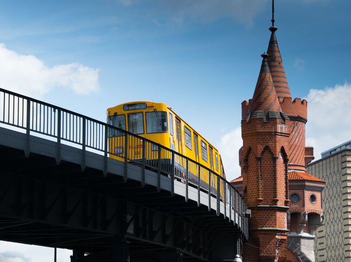 Low Angle View Of Train On Oberbaum Bridge Against Sky