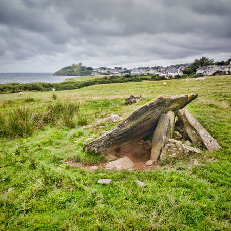 Prehistoric burial chamber near Criccieth, North Wales. Ancient Beauty In Nature Burial Chamber Cloud - Sky Cromlech Day Field Grass Green Color Landscape Log Nature No People Outdoors Scenics Sky Timber Tree