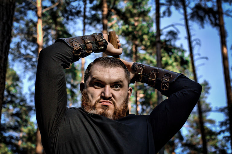Portrait Of Angry Hunter Holding Tool