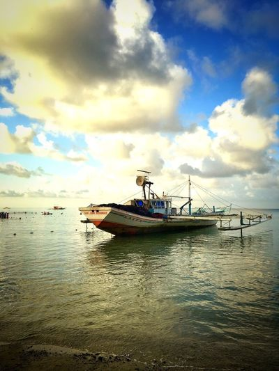 Raw Your Boat Cloud - Sky Water Sky Nautical Vessel Transportation Sea Mode Of Transportation Nature Scenics - Nature Day Beauty In Nature No People Waterfront Travel Land Outdoors Ship Beach Tranquility Fishing Industry