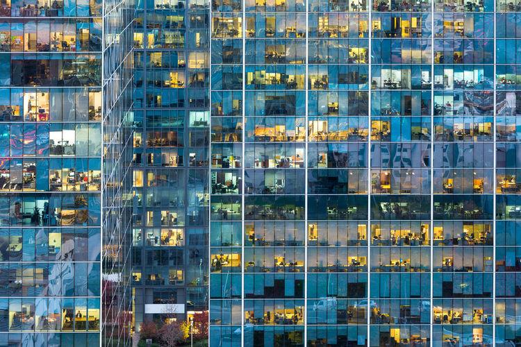 Full frame of modern glass building in city