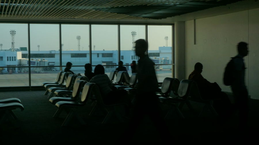 waiting something so long Men Sitting Women Standing Silhouette Side View Airport Departure Area Passenger Boarding Bridge Arrival Departure Board Boarding Airplane Ticket Passenger Airport Terminal Luggage Transportation Building - Type Of Building Waiting