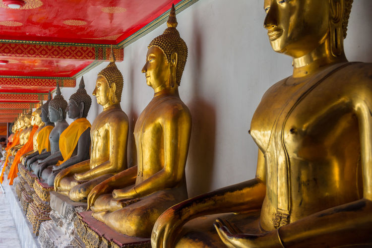 Buddha statue at famous Wat Pho in Bangkok, Thailand Asian  Bangkok Buddha Chedi Culture Famous Famous Place God Gold Gold Colored Golden Indoors  Landmark Place Of Worship Religion Siam Spirituality Statue Temple - Building Thailand Traditional Travel Destinations Wat Pho