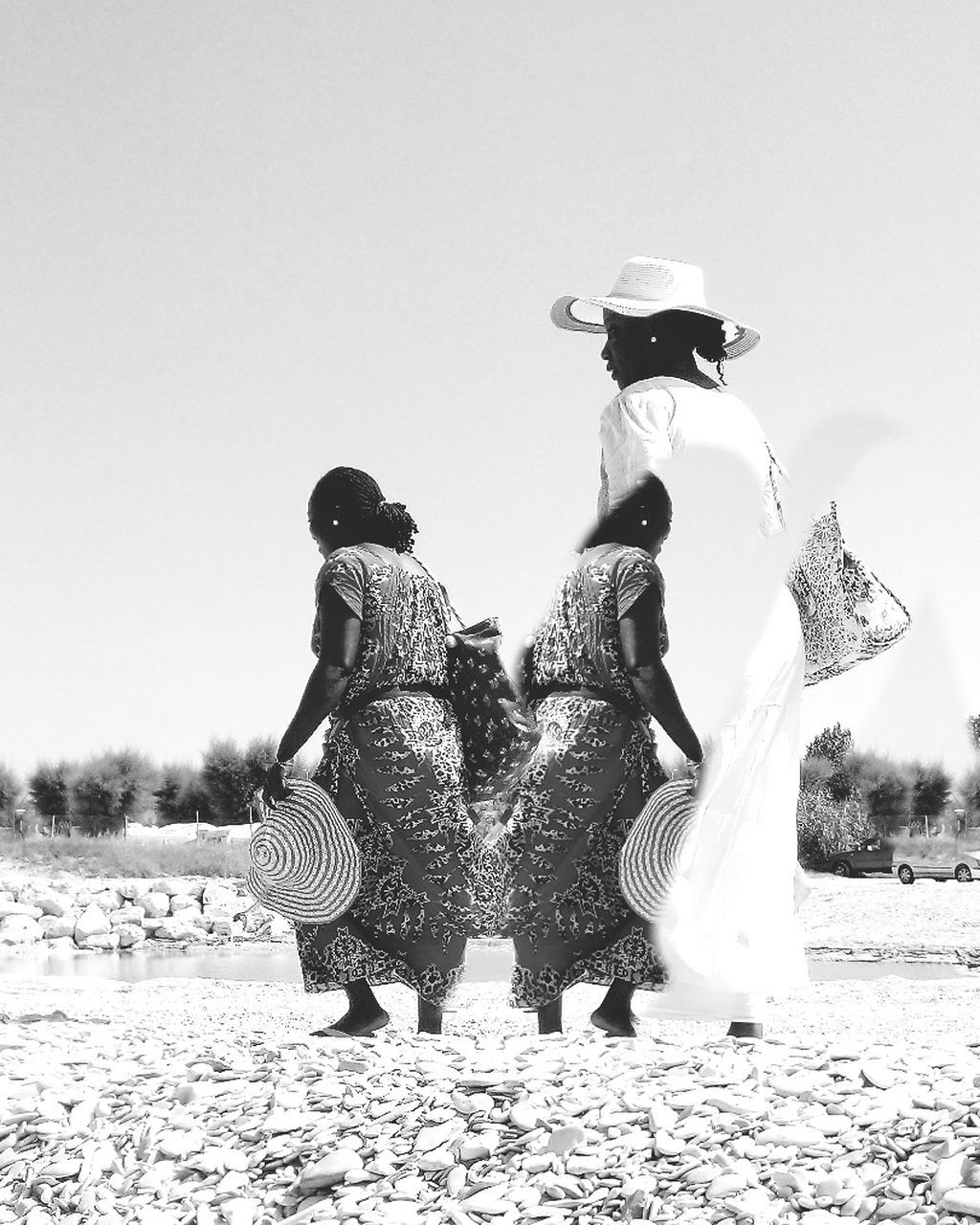 full length, rear view, traditional clothing, real people, clear sky, togetherness, sand, outdoors, leisure activity, standing, women, field, day, two people, beach, lifestyles, bonding, friendship, childhood, young women, nature, sky, young adult