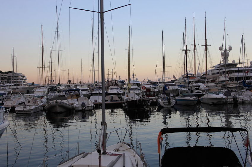 43 Golden Moments Beauty In Nature Blue Boat Harbor Mast Mode Of Transport Moored Nature Nautical Vessel No People Outdoors Port Port Monaco Sailboat Sky Tranquil Scene Tranquility Transportation Water The Innovator The Mix Up Natural Light Portrait