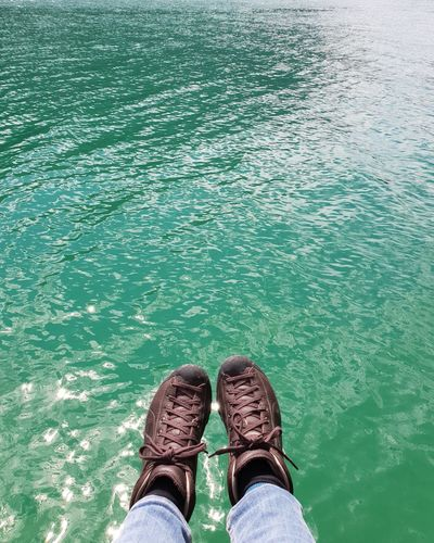 Not beautiful but practical... Lake Swim Good Morning No People Sailing Hike Wanderlust Holidays Happiness Beautiful Place Shades Of Green  The Great Outdoors - 2018 EyeEm Awards The Traveler - 2018 EyeEm Awards Hiking Boots Trails Clean Water Mountain View Breath Summer Low Section Water Human Leg Shoe Personal Perspective High Angle View Footwear Human Feet Ankle Deep In Water Pair Shoelace