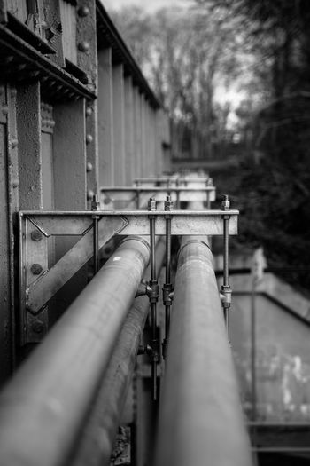 Close-up of pipe on railing