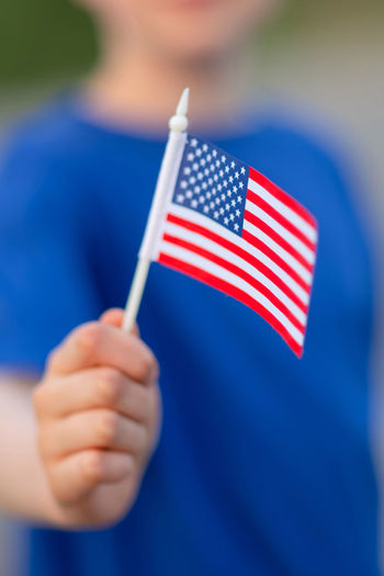 USA flag One Person Flag Holding Patriotism Blue Striped Real People Focus On Foreground Human Hand Pride Human Body Part Hand Close-up Men Child Red National Icon Independence