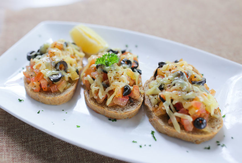 Tomato Bruschetta with cheese Close-up Day Food Food And Drink Freshness Healthy Eating Indoors  No People Plate Ready-to-eat Serving Size