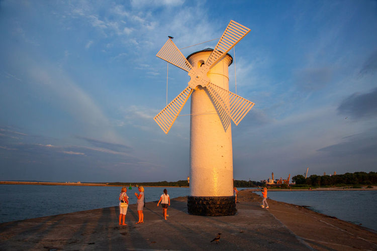 Baltic Sea Stawa Mlyny Adult Architecture Beach Cloud - Sky Environmental Conservation Fuel And Power Generation Group Of People Horizon Over Water Land Leisure Activity Men Nature Outdoors Real People Renewable Energy Sea Sky Turbine Water Wind Turbine Women