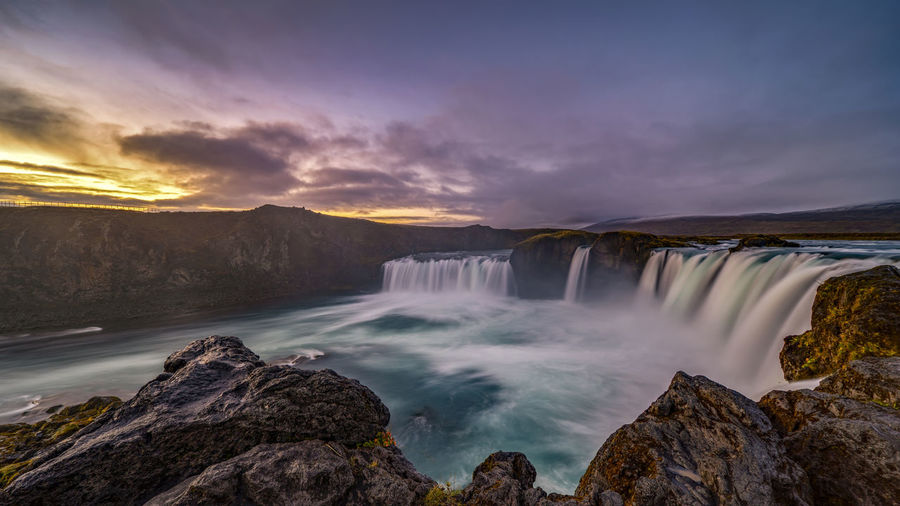 The Goðafoss is a waterfall in Iceland. It is located in the Bárðardalur district of Northeastern Region at the beginning of the Sprengisandur highland road. The water of the river Skjálfandafljót falls from a height of 12 meters over a width of 30 meters. Scenics - Nature Water Beauty In Nature Waterfall Motion Long Exposure Nature Flowing Water No People Outdoors Power In Nature Flowing Goðafoss Waterfall Sunrise Sunset Environment Blurred Motion Majestic Beauty In Nature Horseshoe Falls Rocks Sky Rock Rock - Object Cloud - Sky Solid Non-urban Scene Tranquil Scene Running Water Falling Water