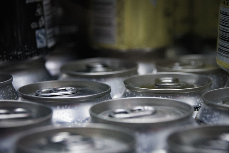 Close-up of drink cans