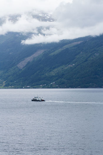 Water Transportation Nautical Vessel Mountain Mode Of Transportation Waterfront Scenics - Nature Cloud - Sky Sky Sea Beauty In Nature Nature Day Tranquil Scene Tranquility No People Travel Non-urban Scene Outdoors Hordaland Nærøyfjorden Norway Nature