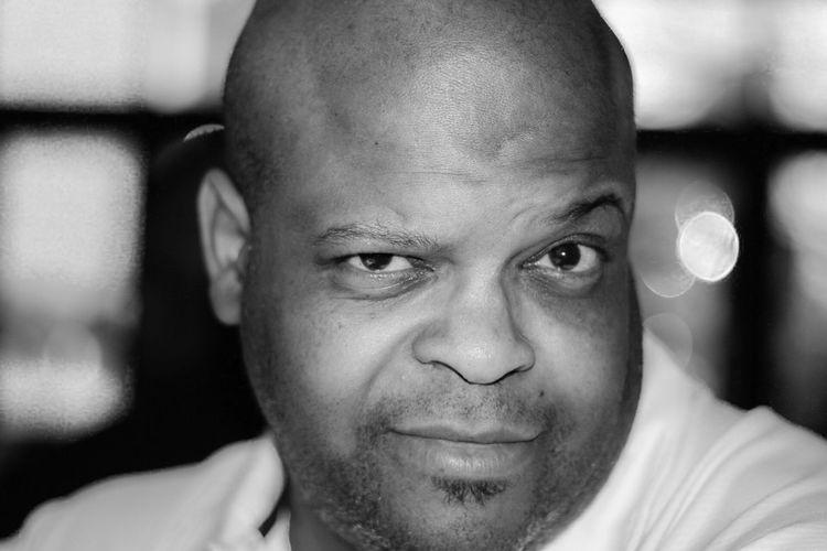 Close-up portrait of bald mature man