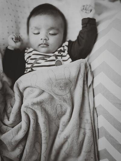 Cute baby girl sleeping at home