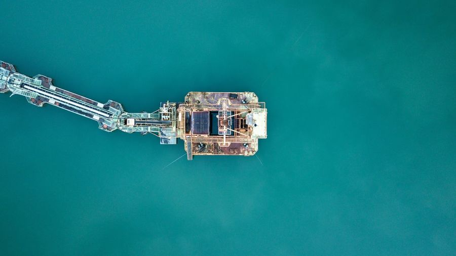 Directly above shot of drilling rig in sea