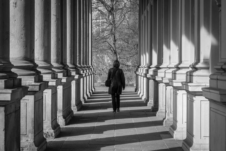 Berlin Photography Black & White Adult Arcade Architectural Column Architecture Berliner Ansichten Black And White Built Structure Colonnade Day Direction Full Length In A Row Kleistpark Leisure Activity Lifestyles Light And Shadow Men One Person Outdoors Pillars Real People Rear View Shadow Standing The Way Forward Walking Warm Clothing