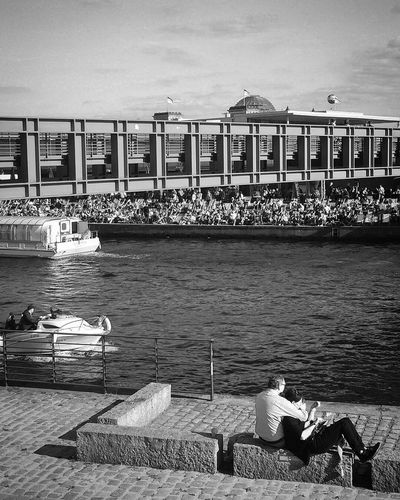 Water Built Structure Architecture River Outdoors Sky Day Sitting Nautical Vessel Building Exterior People Travel Destinations Streetshot Sunny Berlin City Light And Shadow Connection Bridge Couple Bnw Black & White Berliner Ansichten Blackandwhite Photography Black And White