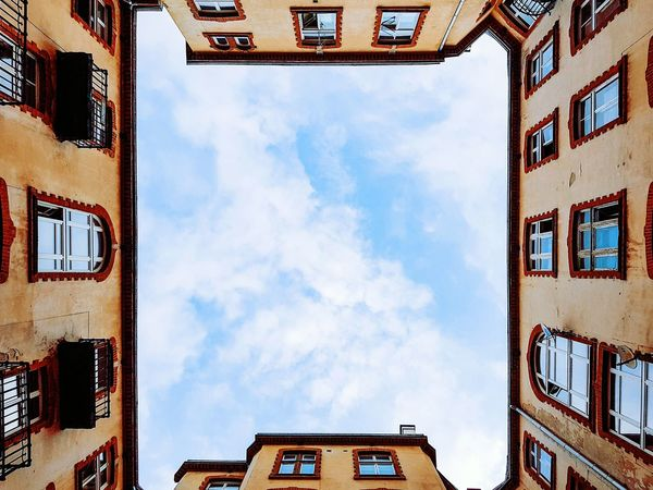 Sky Built Structure Cloud - Sky Architecture Building Exterior Low Angle View No People Outdoors Day Text Clock City Gate Minimal Minimalism City Taking Photos EyeEm Best Shots Low Angle View Window Geometric Shape City Life Phone Camera Street Architecture Clouds And Sky