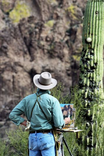 Men Paint Too! Apache Junction Arizona Rural Scenery This Is Masculinity Casual Clothing Day Hat Nature Occupation Outdoors Painting People Portrait Photography Rear View Rural Landscape This Is Aging This Is Aging My Best Travel Photo