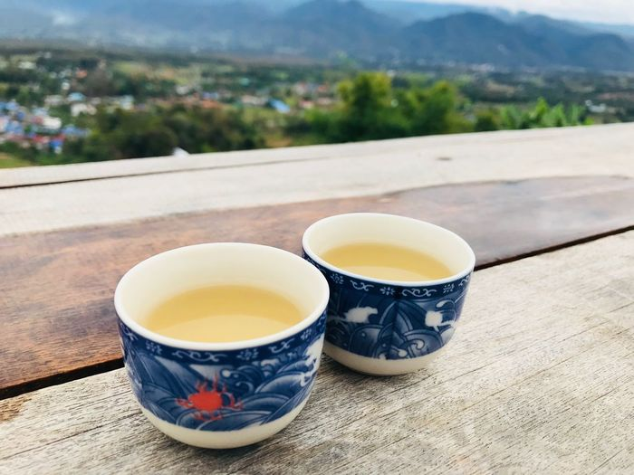 Close-up of tea served on wooden table
