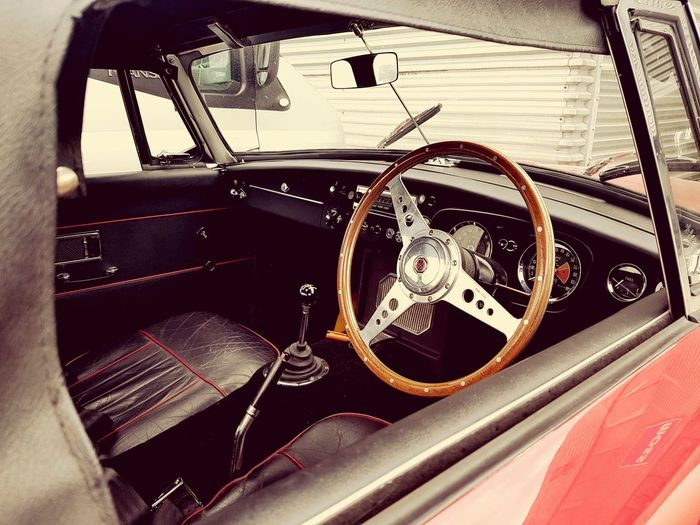 Classic MG Transportation Car Vehicle Interior Mode Of Transport No People Luxury Close-up Dashboard Control Panel Cockpit Lock Day Driving Classiccarspotting Auto Racing Transportation Old-fashioned Land Vehicle Classiccars Outdoors