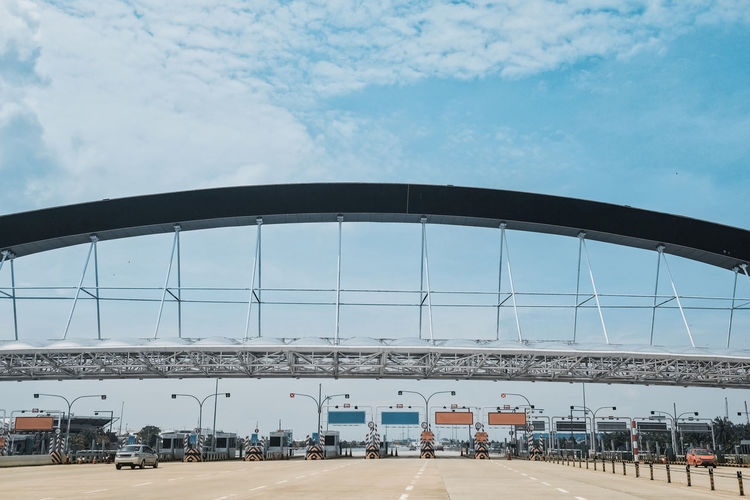 Highway Cloud - Sky Architecture Connection Outdoors Bridge Built Structure Transportation Sky Roads Infrastructure Development Modern Infrastructure Progress Economy Toll Road Travel Journey City Day Sunny