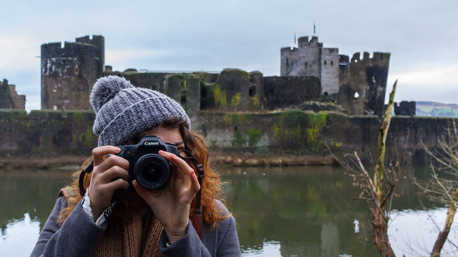 Get out of the way! Adult Architecture Bobble Hat  Camera - Photographic Equipment Canon Castle Day Girl One Person Outdoors People Photographer Photographing Photography Themes Real People Red Hair Ruins Sky Water Women Young Adult