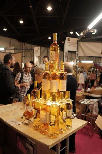 Pyramid of White Wines Indoors  Illuminated Food And Drink Group Of People Business Table Real People Drink Container Lighting Equipment Refreshment Alcohol Focus On Foreground Bottle Bar Counter Wine Fujifilm_xseries