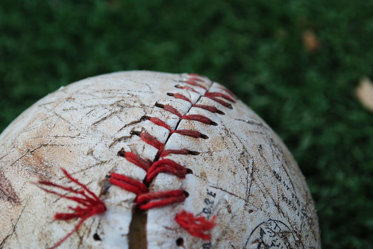 Cropped image of abandoned baseball on field