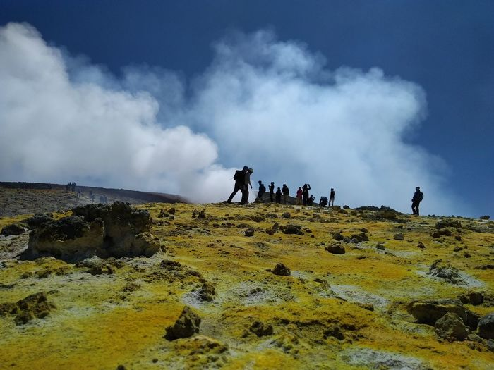 People on the edge of Etna crater. Sulfur gas emissions and a layer of yellow sulfur on the ground Sulfur Gas Edge Of Etna Volcano Etna Etna Volcano Volcanopresso Catania Sicily Silhouette Adventure Mountain Scenics Beauty In Nature Nature The Week On EyeEm EyeEm Nature Lover EyeEm Gallery EyeEmNewHere From My Point Of View. Paint The Town Yellow Lost In The Landscape Volcanic Landscapes Volcanic Landscape