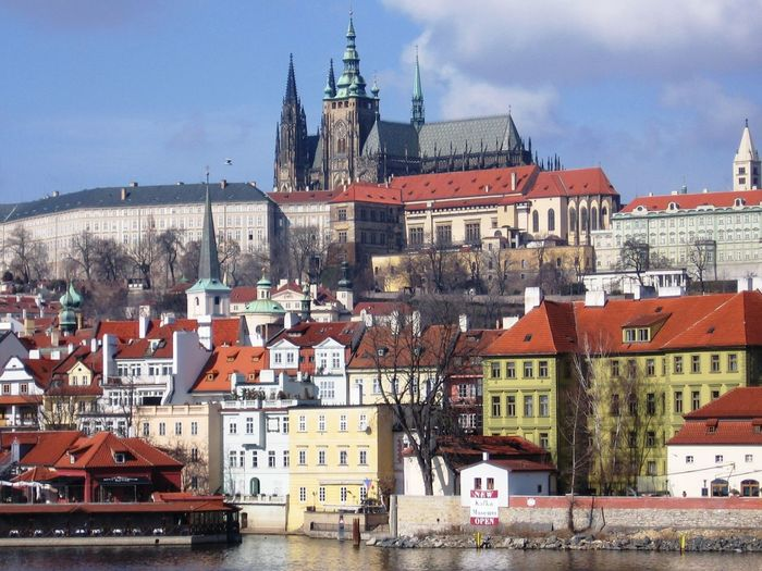 St Vitus Cathedral With Cityscape Against Sky