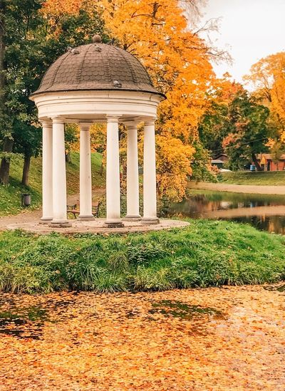 Architecture Plant Built Structure Tree No People Day Nature Green Color Architectural Column Building Water Gazebo Sunlight Building Exterior Growth Travel Destinations Grass Outdoors Lake Reflection