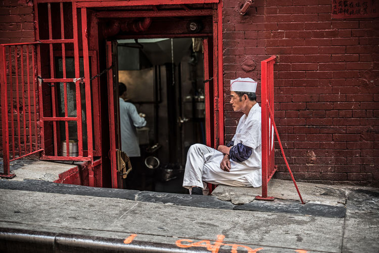 """""""The Rest of the Cook"""" NYC Photography NYC Street NYC EyeEm Best Shots EyeEmNewHere Adult Architecture Building Exterior Full Length Manual Worker Men Occupation One Man Only One Person Only Men Outdoors People Real People Working Stories From The City The Street Photographer - 2018 EyeEm Awards The Art Of Street Photography My Best Photo"""