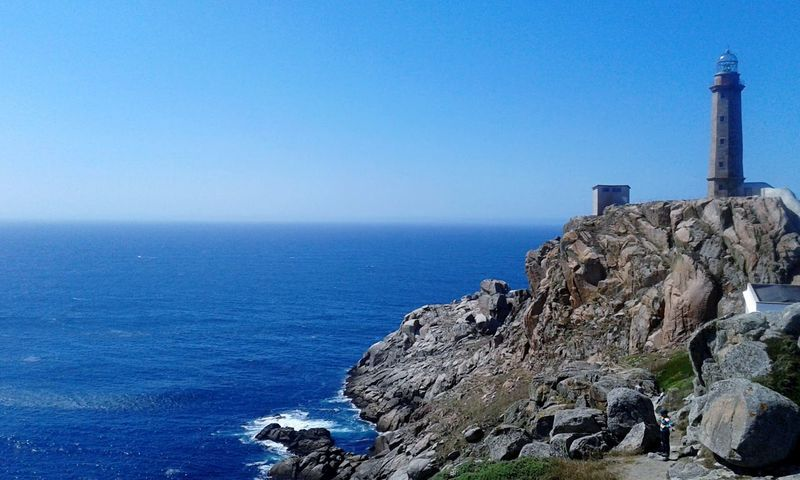 Faro Vilán Sea Water Sky Horizon Over Water Built Structure Horizon Architecture Tower Nature Scenics - Nature Beauty In Nature Rock Blue Solid Building Exterior Clear Sky Rock - Object No People Guidance Lighthouse The Great Outdoors - 2018 EyeEm Awards