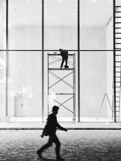 Side view of man walking on street