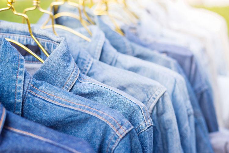 Close up of blue denim jackets