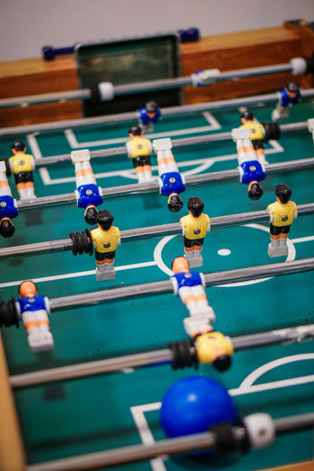 Close-up of figurines on foosball table
