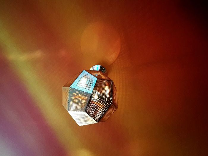 Kurios Illuminated No People Indoors  Low Angle View Shadow Day Lamp Light And Shadow Light Orange Color Modern Indoor Photography Indoor Architecture Metallic