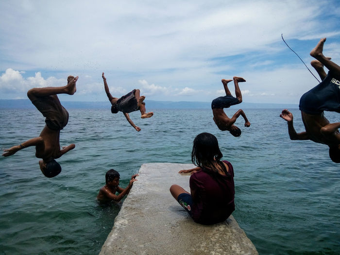 A group of kids enjoy backflipping at the beach of Bolisong, Manjuyod, Negros Oriental. The Photojournalist - 2018 EyeEm Awards The Street Photographer - 2018 EyeEm Awards Cloud - Sky Enjoyment Fun Group Of People Jumping Mid-air Outdoors Real People Sea Sky Water Summer Road Tripping The Mobile Photographer - 2019 EyeEm Awards The Street Photographer - 2019 EyeEm Awards The Photojournalist - 2019 EyeEm Awards