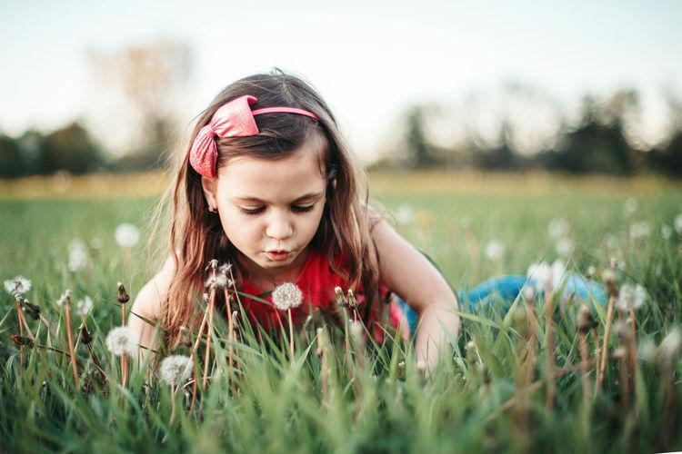 Portrait of girl on field