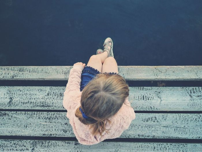 Sitting Rear View Lifestyles Casual Clothing Relaxation Person Long Hair Day In Front Of Summer Solitude Overhead Sitting Alone Overhead View Childhood Tranquility Feet Shoes Child Water Human Hair Young Adult Outdoors Medium-length Hair Jetty View