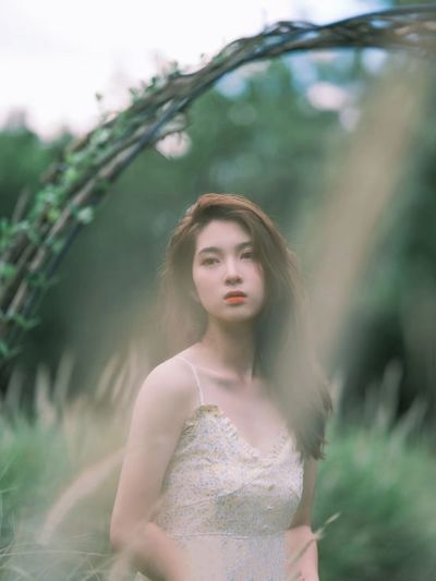Portrait of a beautiful young woman standing outdoors